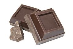 Slices of dark chocolate on a white background stock images