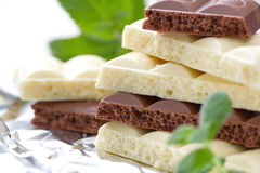 Slices of dark and white chocolate Royalty Free Stock Photo