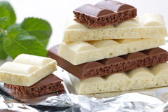 Slices of dark and white chocolate Royalty Free Stock Image