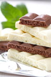 Slices of dark and white chocolate Stock Image