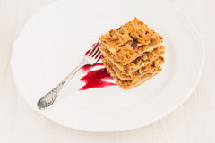 Slices of delicious fresh baked  apple cake on a wooden surface Stock Image