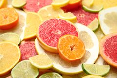 Slices of different citrus fruits. As background stock images