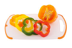 Slices of different colored bell peppers Stock Photography