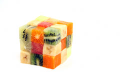 Slices of different fruits in the form of a cube on a white back Royalty Free Stock Image