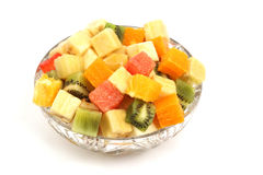 Slices of different fruits in the form of cubes in a plate on wh Royalty Free Stock Photography