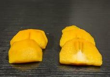 Slices of diospyros kaki. Royalty Free Stock Image