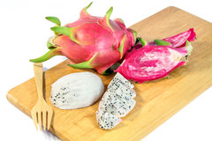 Slices Dragon Fruit on a wooden trencher Stock Photo