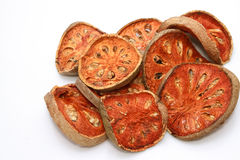 Slices of dried bael fruit Stock Images