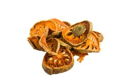 Slices of dried bael fruit on white background Stock Photos