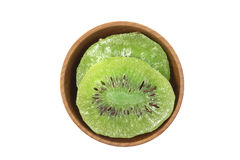 Slices of dried kiwi in a wooden bowl Stock Photography