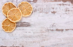 Slices of dried lemon on old wooden background, copy space for text Royalty Free Stock Image