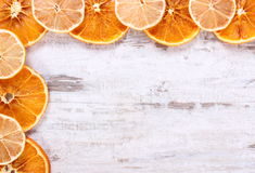 Slices of dried lemon and orange on old wooden background, copy space for text Royalty Free Stock Image