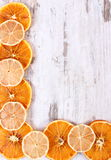Slices of dried lemon and orange on old wooden background, copy space for text Stock Image