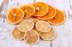 Slices of dried lemon and orange on old wooden background Royalty Free Stock Image