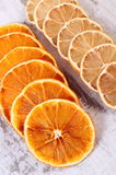 Slices of dried lemon and orange on old wooden background Stock Images