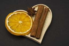 Slices of dried orange with star anise and cinnamon spice stock image