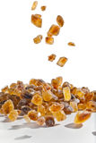 Slices of falling brown candy sugar Stock Image