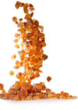 Slices of falling brown candy sugar Stock Photography