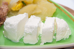 Slices of feta cheese on the plate Royalty Free Stock Photo