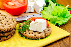 Feta cheese on a round bread with a knife Royalty Free Stock Photography