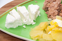 Slices of feta cheese with tuna and potatoes Royalty Free Stock Photography
