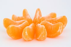 Slices. A few slices of mandarin on a white Royalty Free Stock Photography