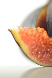 Slices of fig on a white background Royalty Free Stock Photo