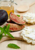 Slices of figs with bread. Figs and slices of bread with cheese and honey Stock Photos