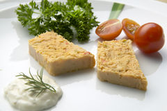 Slices of fish pie on a plate with salad Royalty Free Stock Images