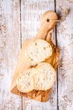 Slices of french Baguette on cutting board Royalty Free Stock Photography