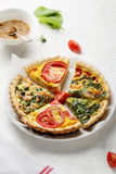 Slices of french quiche stock images