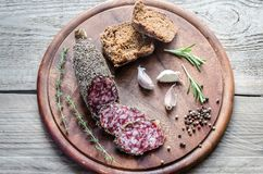 Slices of french saucisson sausage with bread Royalty Free Stock Images