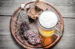 Slices of french saucisson sausage with glass of beer Stock Images