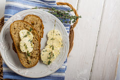 Slices of fresh bread with butter on the grass Stock Photography