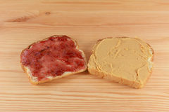 Slices of fresh bread with jelly and peanut butter Royalty Free Stock Image