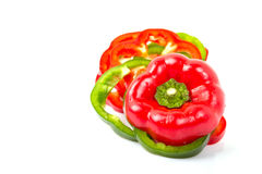 Slices of fresh colorful bell peppers isolated on white backgrou Royalty Free Stock Photography