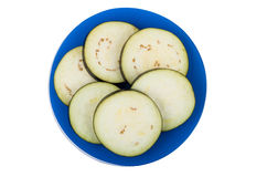 Slices of fresh eggplant on blue plate Royalty Free Stock Image