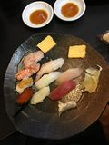 Slices of fresh fish sashimi. Served in a small restaurant in Tokyo fish market royalty free stock photo
