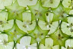 Slices of fresh fruit star and lemon. Stock Photography