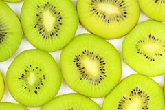 Slices of fresh green kiwi fruits food background texture Stock Photo