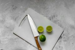 Slices of fresh green lime on the kitchen light board stock photography