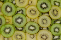 Slices of fresh green and yellow kiwi fruits royalty free stock image
