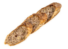 Slices of fresh homemade Alpine Baguette isolated over white. Royalty Free Stock Images