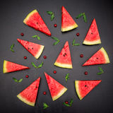 Slices of fresh jucie red watermelon on black background. Royalty Free Stock Image