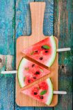 Slices of fresh juicy watermelon on a cutting board with mint Royalty Free Stock Images