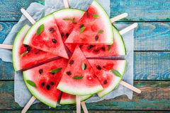 Slices of fresh juicy watermelon on a paper closeup Stock Photos
