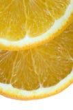 Slices of fresh orange. Macro view of slices of fresh orange with white background Stock Photos