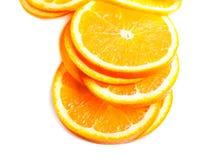 Slices of fresh orange fruit  isolated on white background close Royalty Free Stock Photos