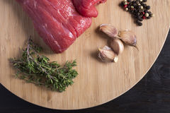 Slices of fresh raw beef. Delicious sliced beef prepared for cooking Royalty Free Stock Photos