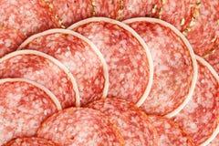 Slices of fresh salami Stock Photo